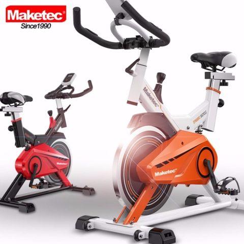 KF-FIT จักรยานออกกำลังกาย SPINNING BIKE MAKETEC สีขาว-ส้ม (15KG.